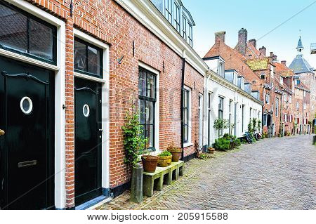 Typical Dutch brick houses in Holland. Street View with bikes parked in the historical center of Amersfoort in the Netherlands