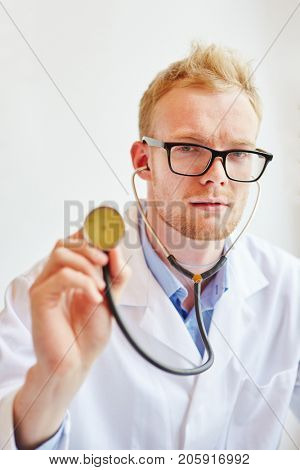 Man as physician with stethoscope to auscultate patients