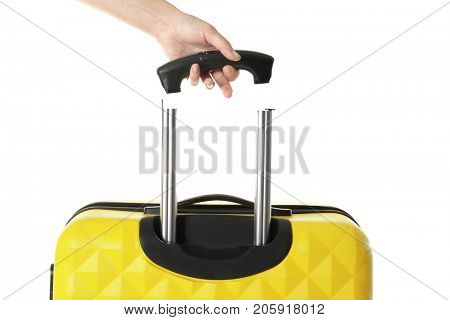 Young woman and suitcase with broken handle on white background
