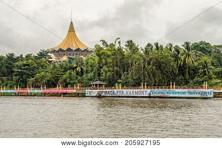 The new Parliament, Kuching, Sarawak, under the water festival in November 2016. Big banners with text. Race for harmony. Kuching water festival