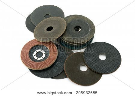 Set cutting discs for angle grinder isolated on white background. Top view.