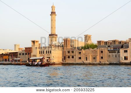 DUBAI UAE - SEPTEMBER 10: The traditional Abra boat with people in Dubai Creek on September 10 2013 in Dubai United Arab Emirates. The Abra is cheapest transport in Dubai