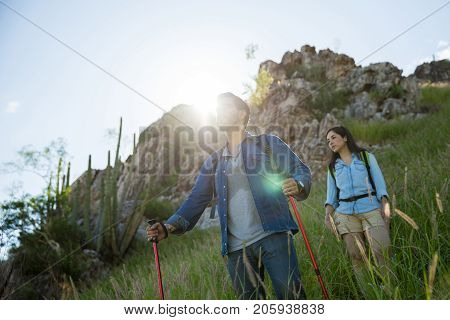Attractive Couple Hiking During Sunrise