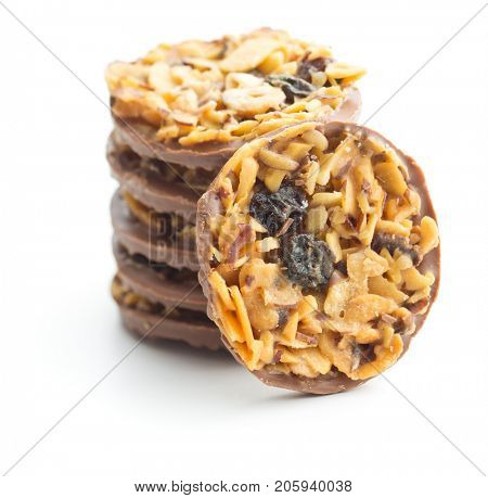 Chocolate chip cookies with nuts and raisins isolated on white background.