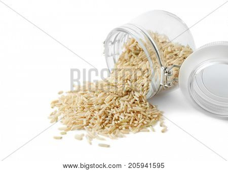 Long grain brown rice and glass jar on white background