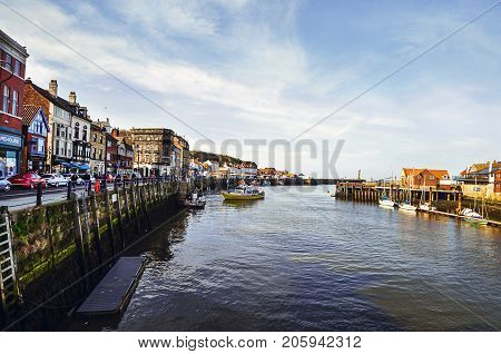 Whitby, North Yorkshire, United Kingdom - April 4, 2017: view of the river Esk and the town of Whitby on a sunny spring day.