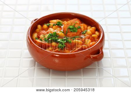 Braised with chorizo and white kidney beans, spanish tapas food,guiso de alubias blancas con chorizo