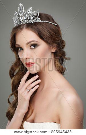 Portrait of beautiful bride. Wedding dress. Wedding decoration.  Gray background