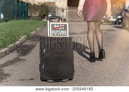 Past and Future concept. woman with travel bag on the street, getting ready for jorney.
