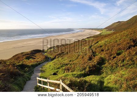 Rhossili Bay is three miles of golden sand accessed via a steep path down from the clifftop. The furthermost western beach on the Gower Peninsular.