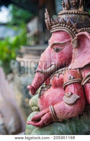 Beautiful pink ceramic Ganesha statue, god in Hindu
