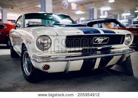 ST PETERSBURG, RUSSIA - JUNE 1, 2017: Ford Mustang GT, white glossy and shiny old classic retro car oldtimer, icon of the USA style.