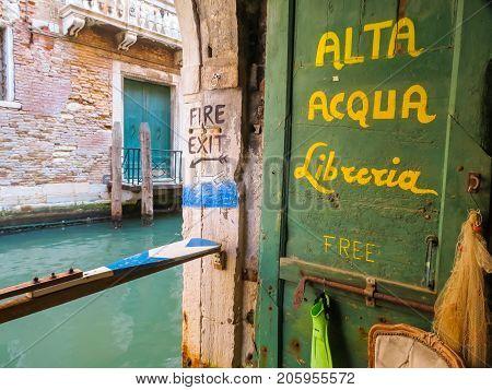 VENICE, ITALY - SEPTEMBER 3, 2013: Sign of bookstore Alta Acqua Libreria famous bookshop in Venice, Italy