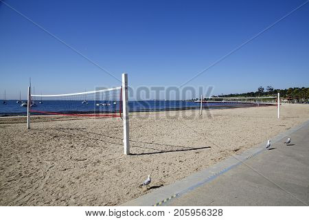 Geelong, Australia: April 03, 2017: Volley ball court on the beach at Geelong. Young adults come after college or work and play on the courts in the evenings.