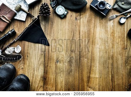 Aerial view of camping stuff on wooden background