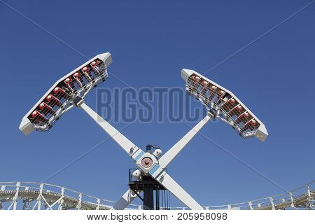 Melbourne, Australia: March 18, 2017: People enjoy the ride at the funfair in Melbourne's Luna Park. The historic amusement park is located on the foreshore at Port Phillip Bay it was opened in 1912