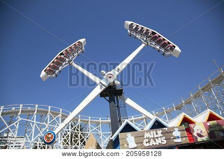 Melbourne, Australia: March 18, 2017: Tourists enjoy the ride at the funfair in Melbourne's Luna Park. The historic amusement park is located on the foreshore at Port Phillip Bay it was opened in 1912