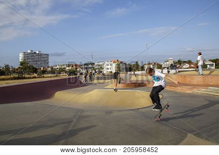 Melbourne, Australia: March 16, 2017: Young adults skateboard in a park on the foreshore at St Kilda. The park has been provided by the municipal council of Victoria.