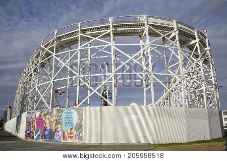 Melbourne, Australia: March 16, 2017: Outside view of the iconic wooden rollercoaster at Melbourne's historic Luna Park located on the foreshore of Port Phillip Bay in St Kilda