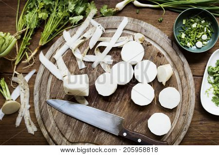Closeup of fresh chinese white radish on wooden cut board