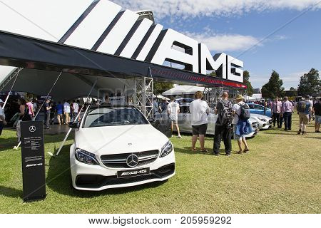 Melbourne, Australia: March 25, 2017: Mercedes AMG sports cars on display at Melbourne's Albert Park. Car enthusiasts look admiringly at the super car