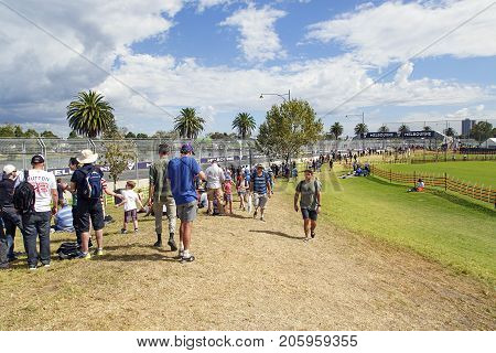 Melbourne, Australia: March 25, 2017: Spectators walk to the viewing areas for general admission at the annual Formula One event at Melbourne's Albert Park