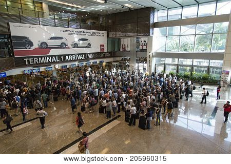 Changi Airport, Singapore: March 05, 2017: People wait to pass through immigration at Changi Airport. Changi Airport is one of the largest transportation hubs in Southeast Asia.