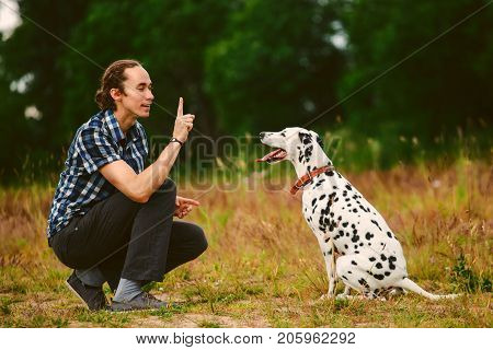 Owner With Dog On Field