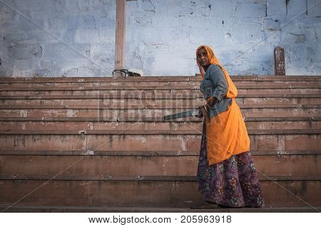 Pushkar India : 17th February 2015 - A shot of an Indian lady in traditional clothing by the stairs at Pushkar Lake India
