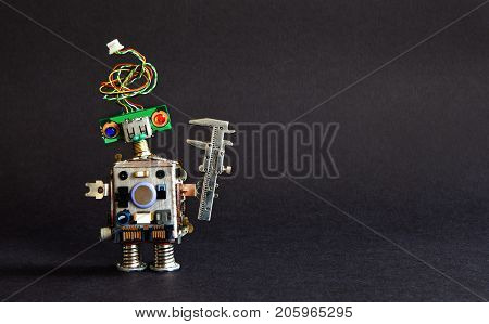 Industry 4.0 automation technology concept. Creative design robot engineer caliper on black background. Copy space photo.