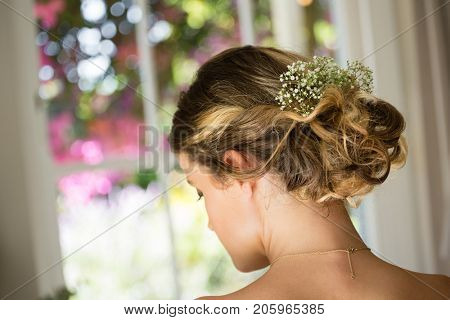 Close up rear view of bride hair with flowers