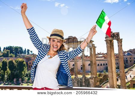 Happy Elegant Woman In Rome With Italian Flag Rejoicing
