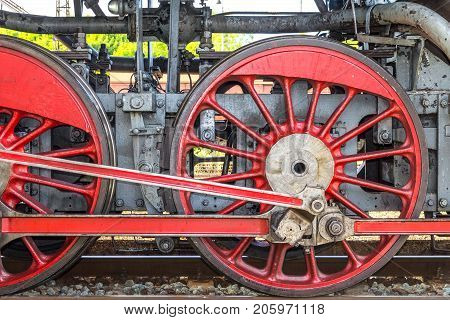 A steam locomotive wheels in red color.