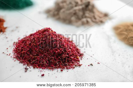 Pile of maqui berry powder on white background