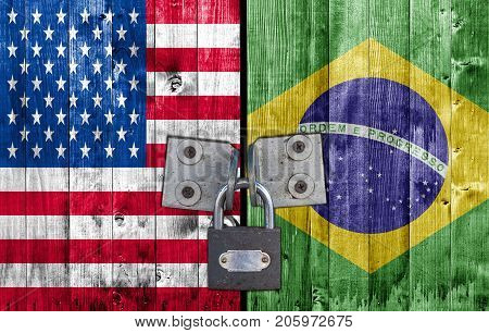 US and Brasil flag on door with padlock