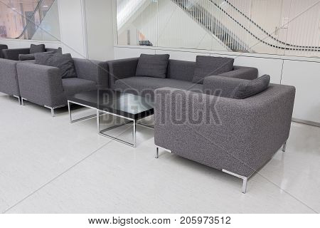 Dark Grey Fabric Sofa In Waiting Room Or Contemporary Office Interior With Lounge Area, Workplaces.