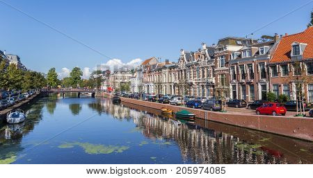 HAARLEM, NETHERLANDS - SEPTEMBER 03, 2017: Panorama of historic houses at the Nieuwe Gracht canal in Haarlem Netherlands