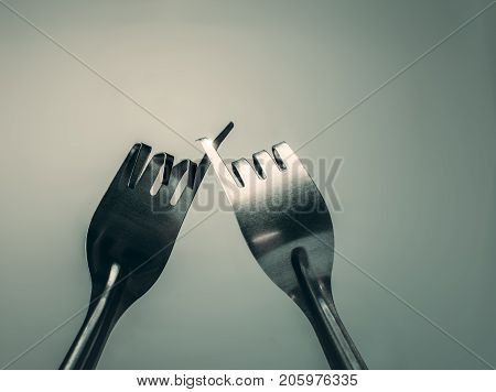 Fork hook each other promise peace friendship background concept.