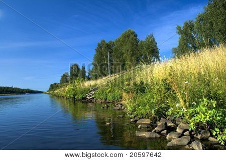 River bank against deep blue sky