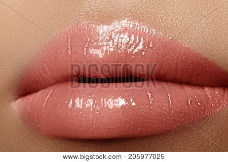Moisturizing lip balm lipstick. Close-up of a beautiful sexy wet lips. Nice full lips with gloss lip makeup. Filler Injections Plastic Surgery Collagen and Treatments poster