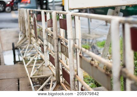 mobile steel fence at a barrier on street.Steel barricades row