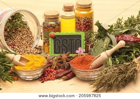 Various colorful spices on wooden table. Set of various aromatic colorful spices and herbs
