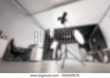 Photo studio with lighting equipment. Blur background.