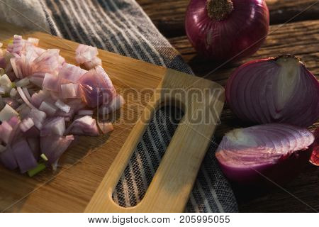 Close-up of chopped onion on chopping board