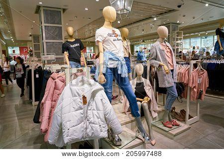 SAINT PETERSBURG, RUSSIA - CIRCA AUGUST, 2017: inside Stradivarius store at Galeria shopping center. Stradivarius is an international women and men clothing fashion brand