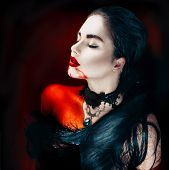 Beauty Halloween Sexy Vampire Woman with dripping blood on her mouth lying in a bath full of blood. Vampire Fashion Art design scene, sexy female vampire girl in a bloody bath. Desire, thirst concept poster