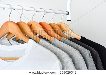 Close Up Collection Of Black, Gray And White Color (monochrome) Hanging On Wooden Clothes Hanger In