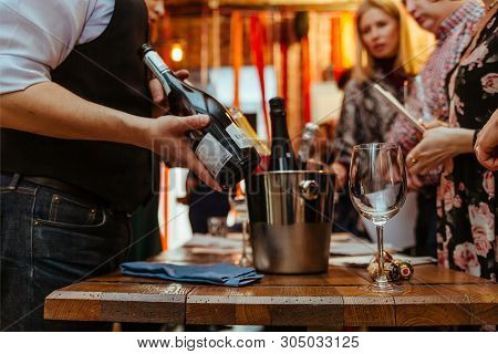 Moscow, Russia-march 30, 2019: Wine Tasting: The Sommelier Offers To Tasting The Wine From The Bottl