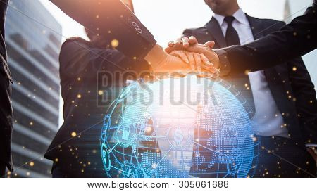 Close Up Of Businessmen Shaking Hands. Global Network And A World Map In The Foreground. Block Chain