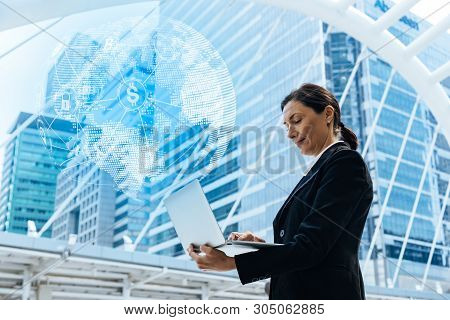 Women With Laptop In Open Space Office.block Chain.business And Technology Concept.